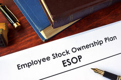 Papers with Employee Stock Ownership Plan (ESOP). On a table Stock Photo