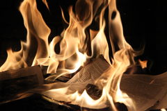 Papers in the fireplace Royalty Free Stock Images
