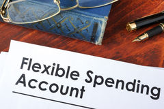 Papers with flexible spending account FSA. Stock Photo