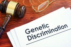 Papers about Genetic Discrimination. Papers about Genetic Discrimination and gavel Royalty Free Stock Photography