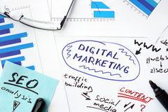 Papers with graphs and digital marketing Royalty Free Stock Photography