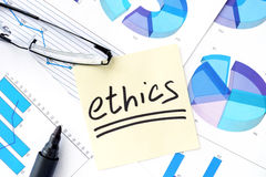 Papers with graphs, glasses and ethics business Stock Photo