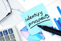 Papers with graphs and Identify Prospects concept. Royalty Free Stock Photo