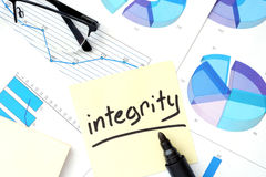 Papers with graphs and integrity concept. Royalty Free Stock Photos