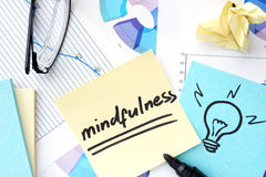 Papers with graphs and mindfulness concept. Royalty Free Stock Images