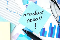 Papers with graphs and Product Recall concept. Papers with graphs, glasses and Product Recall concept Stock Photo