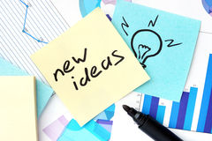 Papers with graphs, stickers and New Ideas Stock Photo
