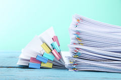 Papers with paperclips and clamps Stock Photography