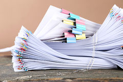 Papers with paperclips and clamps Royalty Free Stock Images