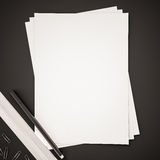 Papers with ruler, pen and clips on black background, 3d rendered Stock Image