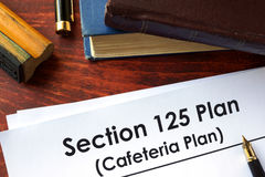 Papers with Section 125 Plan Cafeteria Plan. On a table Royalty Free Stock Photography