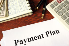 Papers with title payment plan. Royalty Free Stock Photo