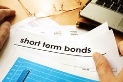 Papers with title short term bonds. Papers with title short term bonds on a table Royalty Free Stock Image