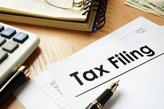 Papers with title Tax filing on an office desk. Taxation concept Royalty Free Stock Photo