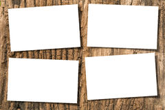 Papers on wood. White papers on ancient wood with drop shadow Stock Photo