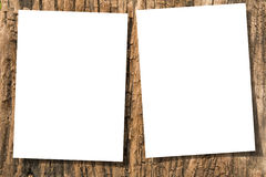 Papers on wood. White papers on ancient wood with drop shadow Royalty Free Stock Image