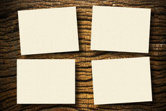 Papers on wood. Cream papers on ancient wood with drop shadow Stock Images