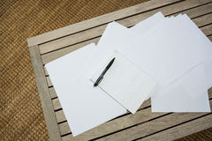 Papers on wooden table. In living room Royalty Free Stock Images