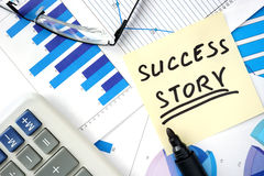 Papers with words success story Stock Images