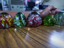 Paperweight of Many Size In Office stock images