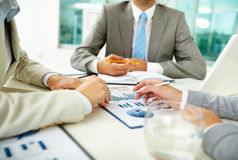 Paperwork. Image of human hands with pens over business documents at meeting Stock Image