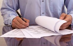 Paperwork. Businessman signing doing the paperwork Stock Photography