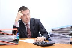 Paperwork. Businessman is stressed with large paperwork and has headache Stock Photography