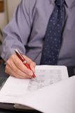 Paperwork. Businessman filling in the tax form royalty free stock image