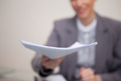 Paperwork being handed over by businesswoman Royalty Free Stock Photo