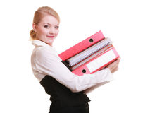 Paperwork. Businesswoman carrying stack of documents Royalty Free Stock Image
