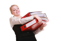 Paperwork. Businesswoman carrying stack of documents. Business and paperwork. Busy businesswoman carrying stack of folders with files documents isolated on white Royalty Free Stock Photo
