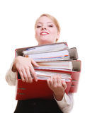 Paperwork. Businesswoman carrying stack of documents. Business and paperwork. Busy businesswoman carrying stack of folders with files documents isolated on white Royalty Free Stock Photography