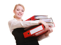 Paperwork. Businesswoman carrying stack of documents. Business and paperwork. Busy businesswoman carrying stack of folders with files documents isolated on white Stock Photo