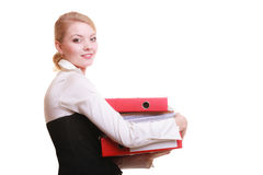 Paperwork. Businesswoman carrying stack of documents. Business and paperwork. Busy businesswoman carrying stack of folders with files documents isolated on white Royalty Free Stock Images
