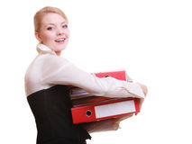 Paperwork. Businesswoman carrying stack of documents. Business and paperwork. Busy businesswoman carrying stack of folders with files documents isolated on white Royalty Free Stock Image