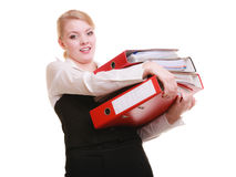 Paperwork. Businesswoman carrying stack of documents. Business and paperwork. Tired overworked busy businesswoman carrying stack of folders with files documents Stock Images