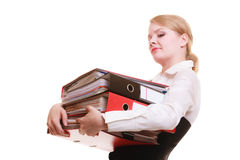 Paperwork. Businesswoman carrying stack of documents. Business and paperwork. Tired overworked busy businesswoman carrying stack of folders with files documents Stock Photo