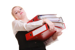 Paperwork. Businesswoman carrying stack of documents. Business and paperwork. Tired overworked busy businesswoman carrying stack of folders with files documents Royalty Free Stock Images