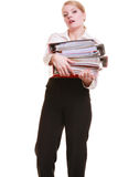 Paperwork. Businesswoman carrying stack of documents. Business and paperwork. Tired overworked busy businesswoman carrying stack of folders with files documents Stock Photography