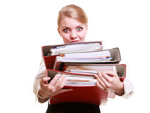 Paperwork. Businesswoman carrying stack of documents. Business and paperwork. Tired overworked busy businesswoman carrying stack of folders with files documents Royalty Free Stock Image