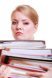 Paperwork. Businesswoman carrying stack of documents. Business and paperwork. Tired overworked busy businesswoman carrying stack of folders with files documents Royalty Free Stock Photos