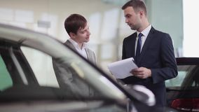 Paperwork before buying a car stock video