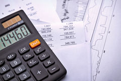 Paperwork and Calculator. A calculator next to financial paperwork Stock Photography