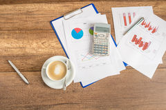 Paperwork and coffee on a business desk Stock Photos