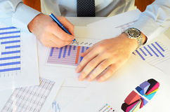 Paperwork. A man doing paperwork in the office Royalty Free Stock Images