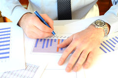 Paperwork. An office worker doing paperwork Royalty Free Stock Photography