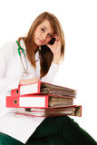 Paperwork. Overworked doctor woman with documents Stock Photos