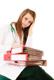 Paperwork. Overworked doctor woman with documents. Medicine and paperwork. Tired overworked busy doctor woman with stack of folders with files documents isolated Royalty Free Stock Photography