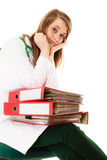 Paperwork. Overworked doctor woman with documents. Medicine and paperwork. Tired overworked busy doctor woman with stack of folders with files documents isolated Royalty Free Stock Photos