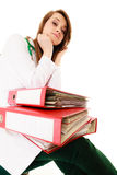 Paperwork. Overworked doctor woman with documents Stock Images